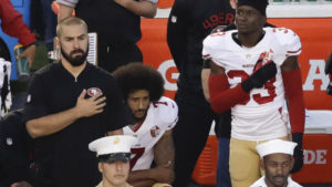 Colin Kaepernick, quarterback for the San Francisco 49ers, kneeled at a game during the National Anthem. Photo credit: Chris Carlson, AP