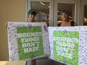 Members of Kappa Sigma and Phi Gamma Delta hold a banner against hazing. (Nicole Strong/TCU360)