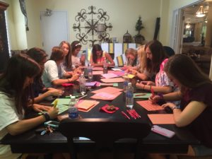 Sorority women make thank you cards for Court Appointed Special Advocate volunteers at Kappa Alpha Theta. (Nicole Strong/TCU360)