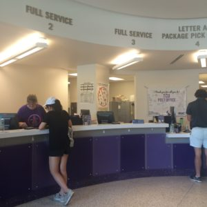 Staff members of the TCU post office attend to students receiving packages or mail.