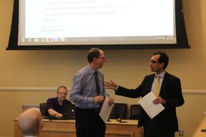 Heath Einstein speaking with Faculty Senate Chair Jesus Castro-Balbi at the Faculty Senate meeting Thursday.