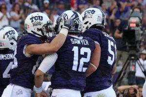 TCU quarterback Foster Sawyer celebrates his touchdown pass against Texas Tech with his teammates. (Sam Bruton/TCU staff photographer)