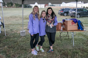 Sigma Kappa seniors Christa Martin, Christina DeMarois and sophomore Charlee Bisch stand under the Sigma Kappa tent getting ready to ask walk participants to sign advocacy cards (Photo courtesy: Alzheimer's Association North Central Texas Chapter).