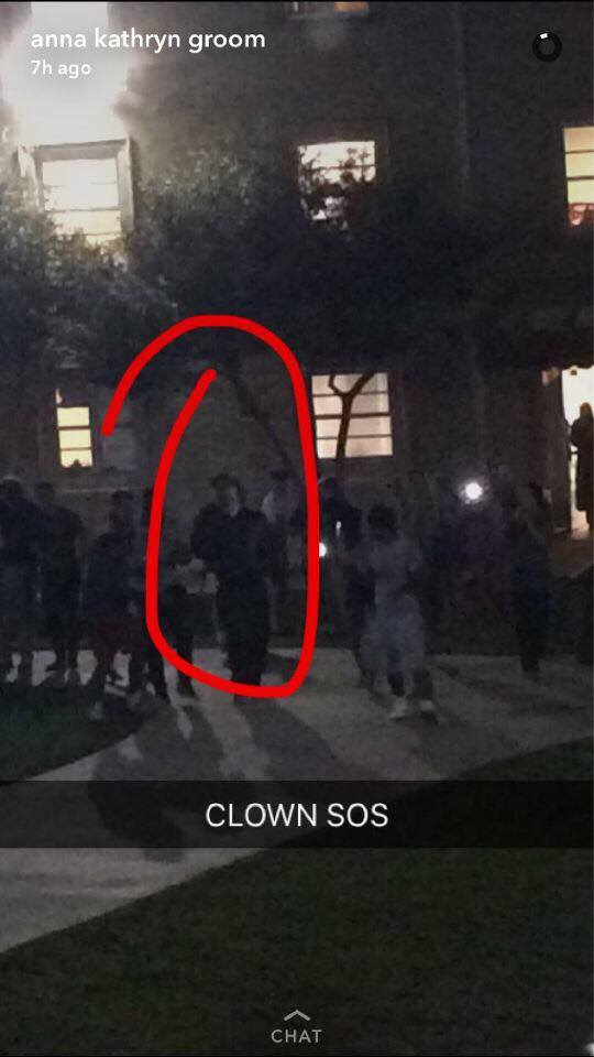 The clown was spotted after midnight wearing a white mask with red rimmed eyes and mouth. The person was walking around campus with two others who were not dressed as clowns.