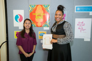 """Chloe Reynaldo with first place winner Majesty Christian. Christian is Junior BFA Graphic Design student. Her artwork - """"You Are All One"""" (Photo Courtesy - )"""