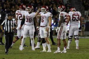 Oklahoma quarterback Baker Mayfield huddles with his teammates against TCU Saturday night. (Sam Bruton/TCU staff photographer)
