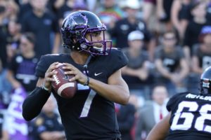 TCU quarterback Kenny Hill scans the field for open receivers against the Oklahoma Sooners. (Sam Bruton/TCU staff photographer)