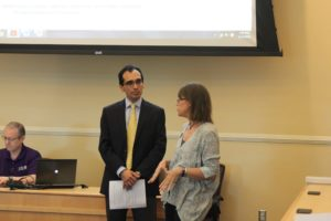 Jane Fry speaking with Chair Jesus Castro-Balbi at the Senate meeting Thursday.