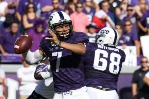 TCU quarterback Kenny Hill looks to throw the football downfield.
