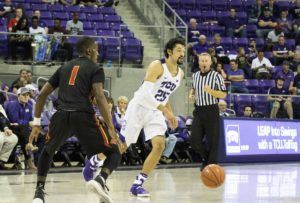 Alex Robinson, sophomore guard, handles the ball in an offensive possession. (Lucy Mariani/TCU Staff Photographer)