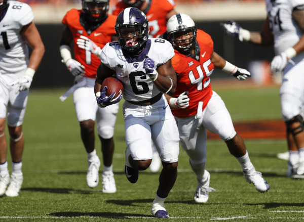TCU running back Darius Anderson breaks off a big run against the Oklahoma State defense in a 44-31 Horned Frog victory. Photo courtesy of GoFrogs.com