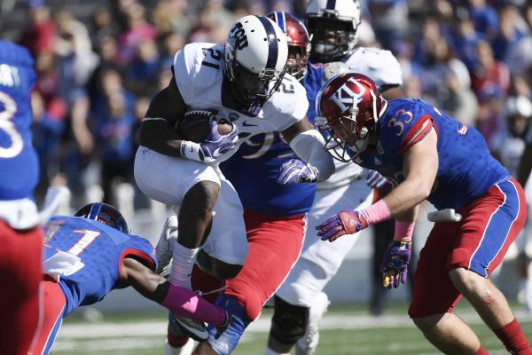 Kyle Hicks runs through the Jayhawks' defense in a 24-23 TCU victory last season. Photo courtesy of GoFrogs.com