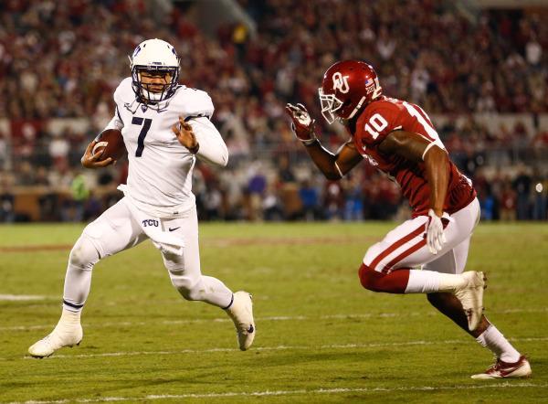 TCU quarterback Kenny Hill evades an Oklahoma defender. Photo courtesy of GoFrogs.com